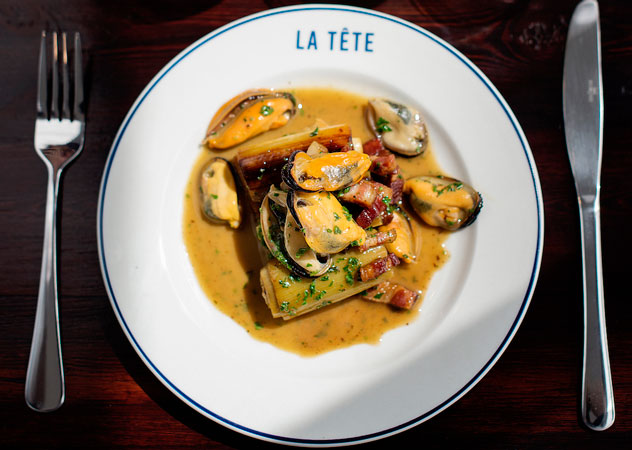A mussel dish prepared and served at La Tête. Photo by Claire Gunn