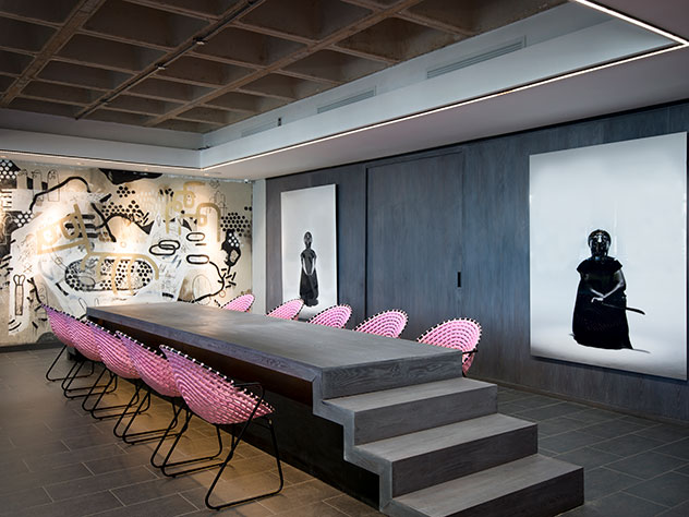 Bold pink is juxtaposed with industrial finishes and lots of grey. Photo by Dook.