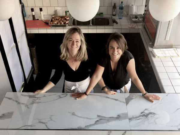 French friends, Delphine de Beer and Catherine Lauria in their new Sea Point rotisserie. Photo supplied.