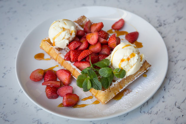 A fresh waffle with ice cream and strawberries. Photo Supplied.