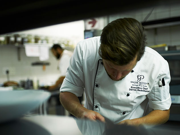 Darren Badenhorst hard at work in the Grande Provence kitchen. Photo supplied.