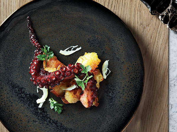 Will the contestant's dishes look like this? One of Higgs's dishes at Marble: blackened octopus with crushed paprika potato, and candied lemon squid. Photo supplied.