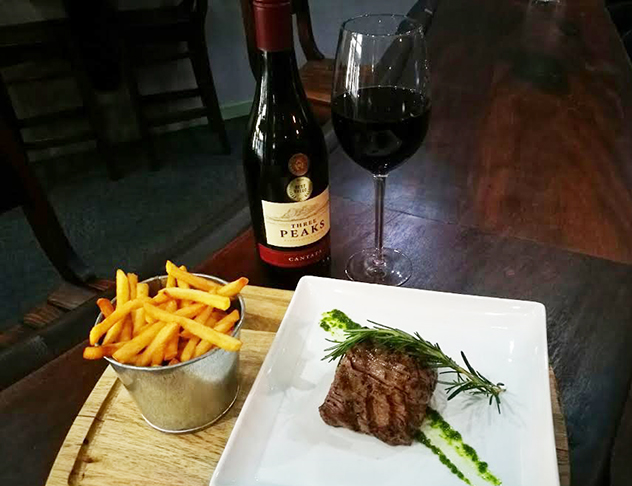 The Cow Shed steak, chips and red wine