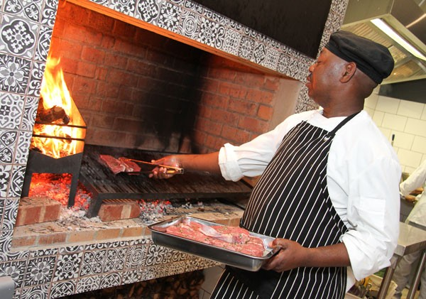 The steaks being grilled at The Eatery Woodfired Grill. Photo supplied.