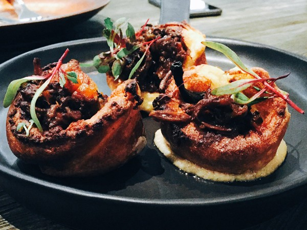 Yorkshire puddings topped with braised oxtail at The Crazy Horse. Photo supplied.