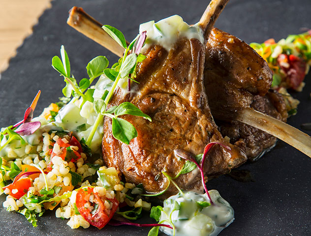 Lamb cutlets with tabbouleh and cucumber raita. Photo supplied.