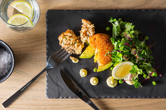 The trout fishcake with avo salad and lemon mayo. Photo supplied.