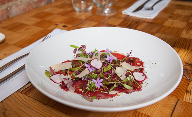 The beef carpaccio with crispy capers, radish, pine nuts and a truffle dressing. Photo supplied.