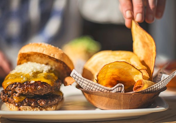 One of the cheesy burgers at Hudson's. Photo by Claire Gunn.