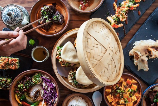A table laden with Asian tapas at Momo Baohaus. Photo supplied.