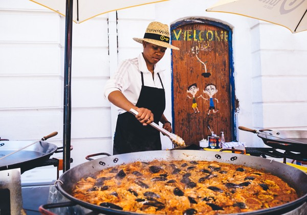 A huge pan of paella being prepared for festival-goers. Photo supplied.