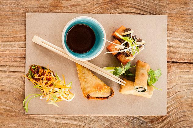 Crispy duck spring rolls, prawn samoosa, kimchi salad and crispy pork belly. Photo supplied.