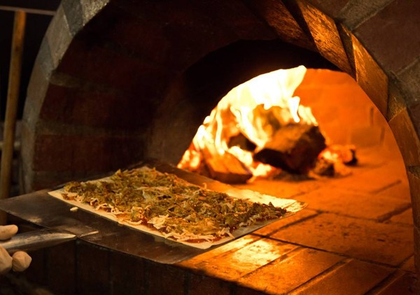 A lamb pizza making its way into the pizza oven at Engruna. Photo supplied.