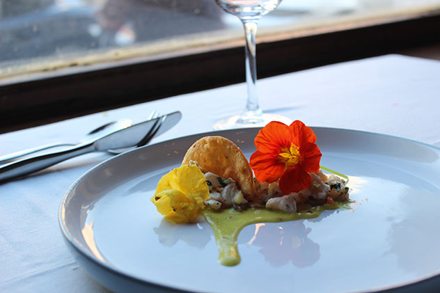 Pineapple with a crisp squid-ink tuille, ceviche and nasturtiums. Photo supplied.