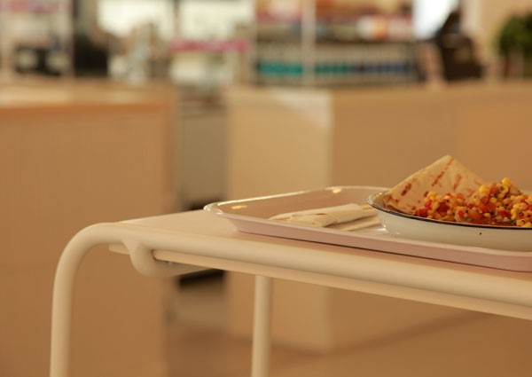 Food served is canteen-style on a melamine tray. Photo supplied.