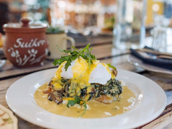 Perfectly poached eggs at The Farmer's Daughter. Photo by Claire Courtney Photography.