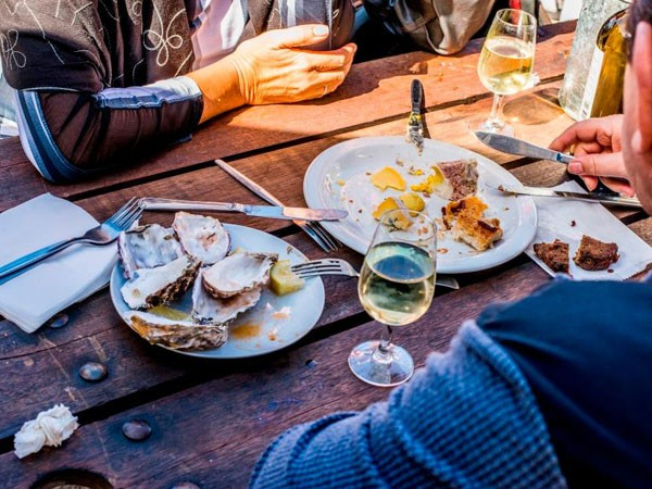 Oysters and wine at the Hermanuspietersfontein Market. Photo supplied.
