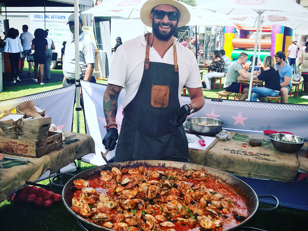 A massive paella being prepared at Eighty 8's food truck