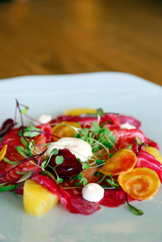 EB's gravadlax of beetroot-stained salmon, creamed cheese, pine nuts, rocket and compressed pineapple
