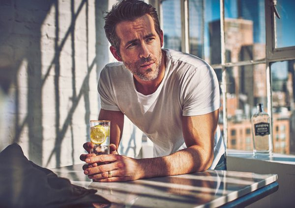 Ryan Reynolds with a gin cocktail