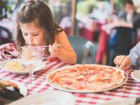 Children eating pizza by Jordan Rowland-unsplash