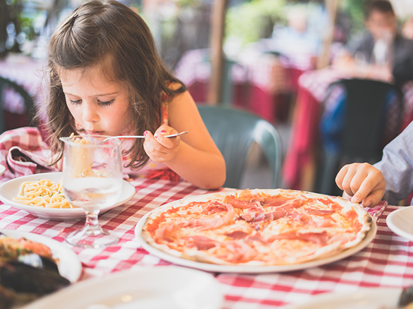 Children eating pizza by Jordan Rowland-unsplash
