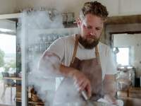 Chef Kobus inside the kitchen at Wolfgat Restaurant