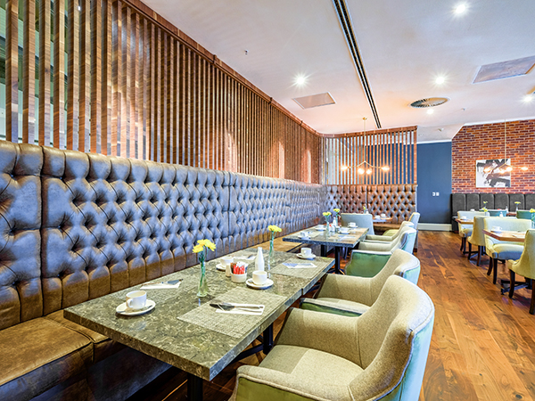 Enjoy happy hour specials at Vivace Restaurant at The Raddison Blu Hotel.