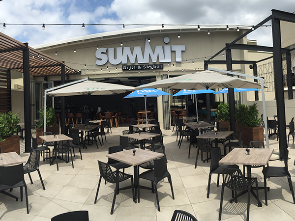 Sit outside and enjoy happy hour specials at Summit Skybar & Grill.