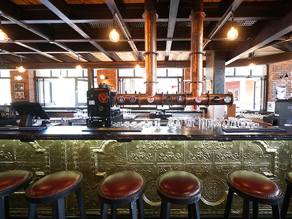 Hit the bar at Tiger's Milk for happy hour specials.