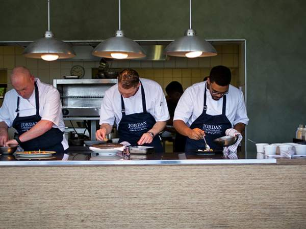 Chef George Jardine with two chefs plating on the pass at Jordan wine estate.Photo supplied.