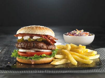 Burger and chips prepared and served at Piatto