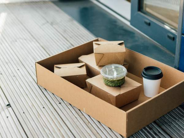 takeaway food boxes on doorstep