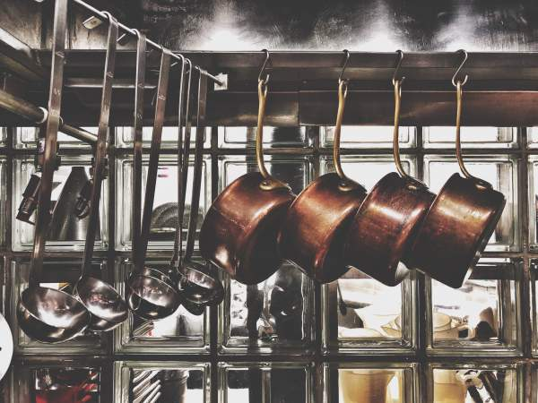 pots hanging up in a kitchen