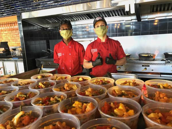 Saigon Suzy staff cooking food for the needy