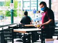 man sanitising restaurant